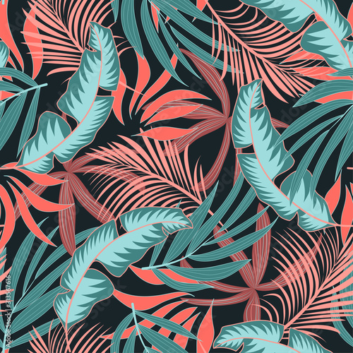 Fashionable seamless tropical pattern with bright pink and blue plants and leaves on a green background. Summer colorful hawaiian seamless pattern with tropical plants. Printing and textiles.