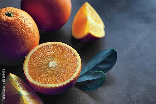 Leinwand Poster Orange citrus fruit on a stone table. Orange background.