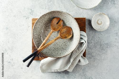 Fotomural Ceramic crockery tableware on a gray background.