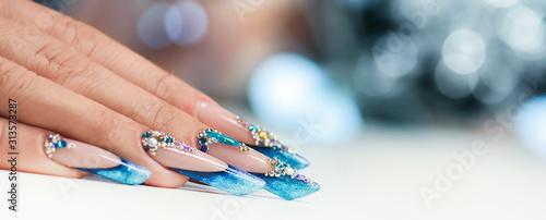 Valokuvatapetti Winter nail art polish, Nails gel technique, Sparkling blue colour background, R