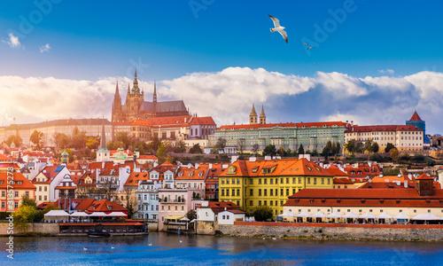Fototapeta Praga  prague-castle-charles-bridge-and-boats-on-the-vltava-river-view-of-hradcany-prague-castle-charles-bridge-and-a-boats-on-the-vltava-river-in-the-capital-of-the-czechia-boat-cruise-on-vltava-river