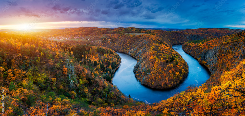 Fototapeta Beautiful Vyhlidka Maj, Lookout Maj, near Teletin, Czech Republic. Meander of the river Vltava surrounded by colorful autumn forest viewed from above. Tourist attraction in Czech landscape. Czechia.