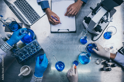 Fototapeta top view workspace in laboratory with microscope, laptop, and laboratory tools