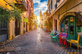 Fototapeta Uliczki - Charming streets of Greek islands, Crete. Street in the old town of Chania, Crete, Greece. Beautiful street in Chania, Crete island, Greece. Summer landscape. Travel and vacation.