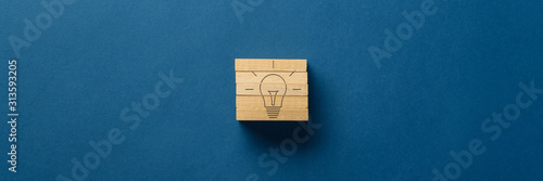 Light bulb shape assembled with wooden pegs