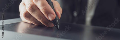 Illustrator working with stylus pen on tablet