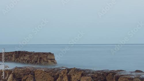 Beautiful sea by rocky wall