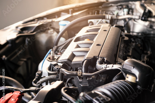 Fototapeta details of modern car engine with sunlight effect, shallow depth of field