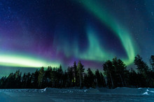 Northern Lights Aurora Borealis Activity Over The Road In Finland, Lapland