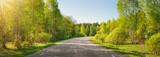 Fototapeta Fototapety z naturą - asphalt road panorama in countryside on sunny summer day