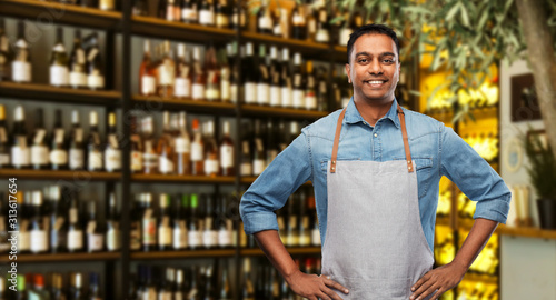 people, job and profession concept - smiling indian barman or waiter in apron ov Wallpaper Mural