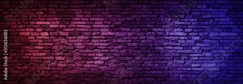 Neon light on brick walls that are not plastered background and texture. Lighting effect red and blue neon background of empty brick basement wall. - 313636083