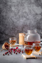 Tea Made From Tea Rose Petals In A Glass Bowl On Drak Black Rustic Background