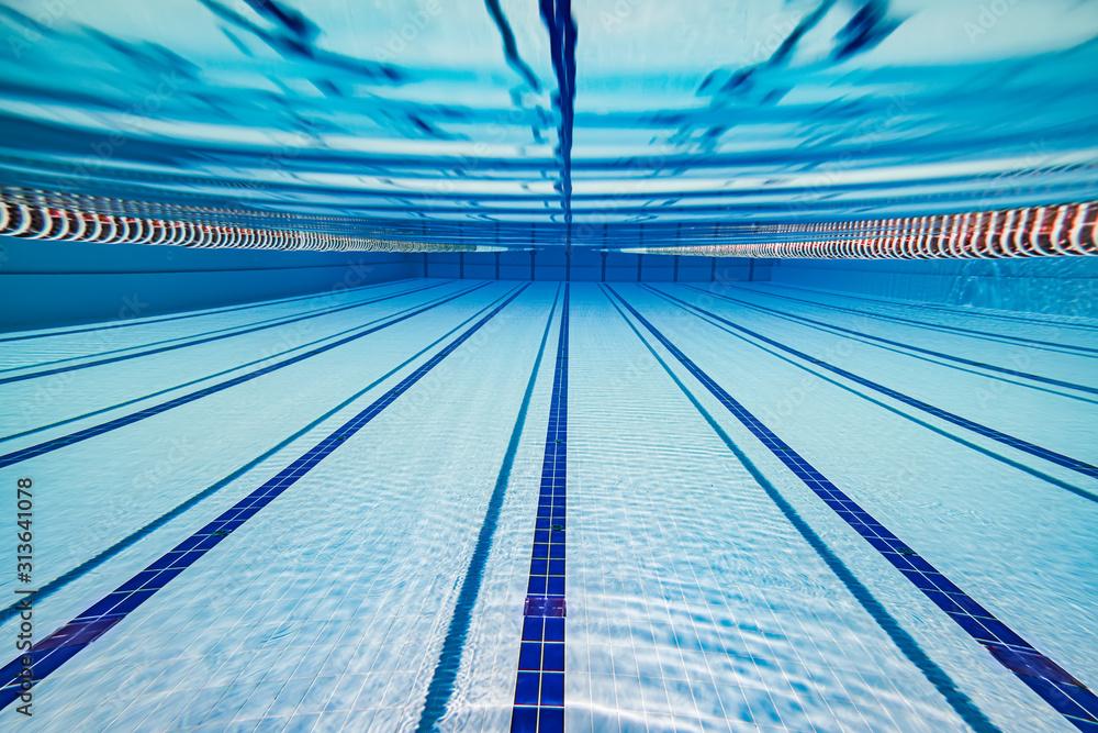 Fototapeta Olympic Swimming pool under water background.