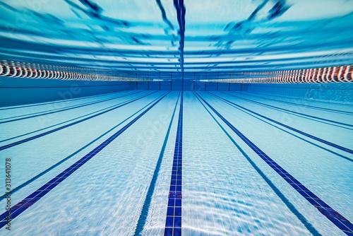 fototapeta na szkło Olympic Swimming pool under water background.