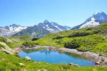 Glacier Lac De Cheserys, Lake Cheserys Near Chamonix-Mont-Blanc In French Alps. Alpine Lake With Snow-capped Mountains In The Background. Tour Du Mont Blanc Trail. The Alps In The Summer Season
