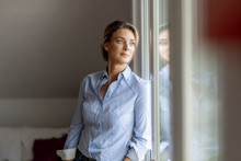 Mature Woman Looking Out Of Th...