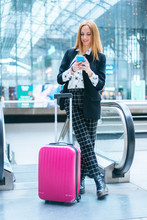 Young Woman With Suitcase And ...
