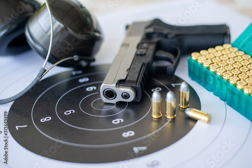 Foto Guns with ammunition on paper target shooting   practice