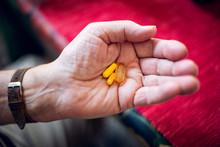 Senior Holding Pills In His Hand
