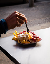 Close Up Of Man's Hand Having French Fries Outdoors