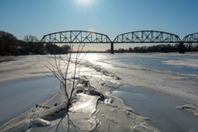 Ice Forming On The Missouri River In North Dakota With Railroad Bridge In The Background