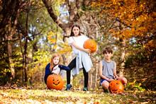 Three Children With Carved Pum...
