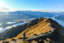 Man Hiking Along Mountain Ridg...