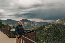 A Retired Man Enjoys An Overlook In Rocky Mountain National Park, CO.