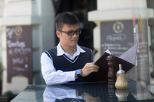 Young Asia Waiter In A Bar