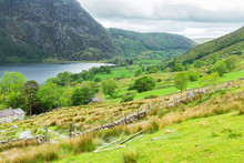 Walk In The Mountains Taking Ranger Path, North Wales, United Kingdom, View Of The Lake, Stone Wall, Selective Focus
