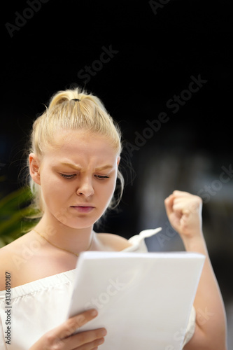 Portrait of angry woman reads negative news in a letter Wallpaper Mural