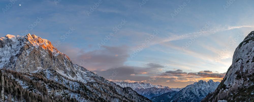 Fototapeta julian alps mountains at sunset winter landscape
