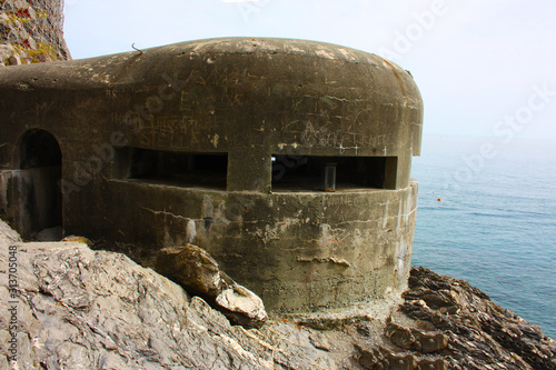Fototapeta old german bunker from the second world war on a cliff overlooking the sea at ci