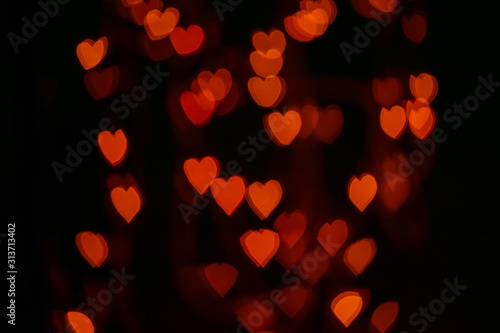 Obraz Valentines background. Abstract heart bokeh background. Defocused blurred heart shaped lights. St. Valentines Day background - fototapety do salonu