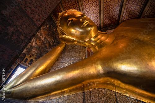 famous golden reclining buddha statue at wat pho bangkok thailand Wallpaper Mural