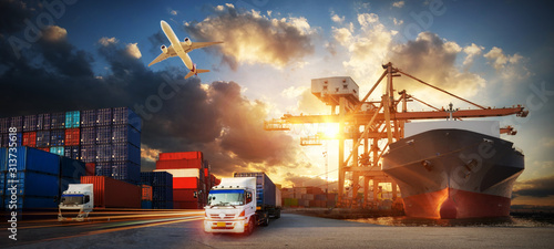 Fotografiet Container truck in ship port for business Logistics and transportation of Contai