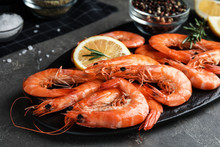 Delicious Cooked Shrimps With Rosemary And Lemon On Dark Grey Table