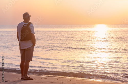 A man admires the sunset on the sea Canvas Print
