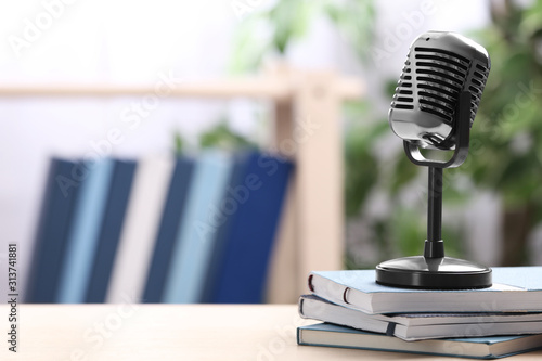 Obraz Retro microphone and notebooks on table indoors, space for text. Job interview - fototapety do salonu
