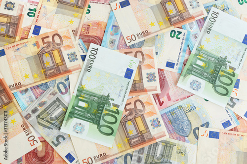 Euro banknotes as background, top view. Money and finance Wallpaper Mural