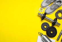 Gym Equipment On Yellow Backgr...