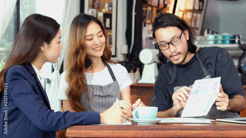 Obraz Young asian business woman discussing about financial planning with small business owner at cafe coffee shop, Business meeting corporate partnership, Asia financal loan for start up new business - fototapety do salonu