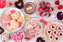Valentines Day Table Scene With A Selection Of Sweets And Cookies. Top View Over A White Wood Background. Love And Hearts Theme.