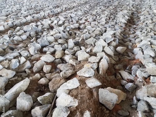 many grey rocks or stones or boulders on ground