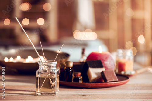 Fotografia Reed diffuser with cosmetics for spa treatment on table
