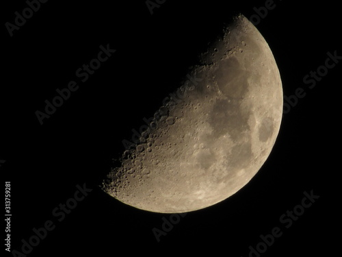 Photo First quarter moon, photographed in San Diego.