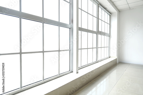Obraz Big modern metal-plastic window in room - fototapety do salonu