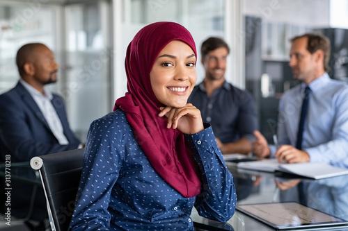 Islamic businesswoman wearing hijab in meeting Canvas Print