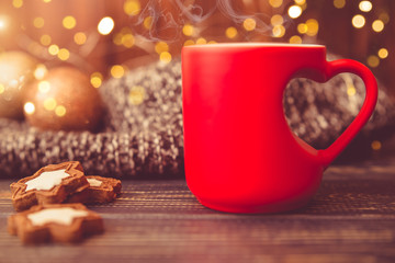 Mug in the shape of a heart on a festive background